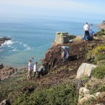 Victoria College students clear hottentot fig at Noirmont, March 2013. Photo by Department of the Environment