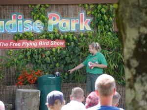 Sarah-Jayne demonstrating can recycling with a kea. Photo by Liz Corry