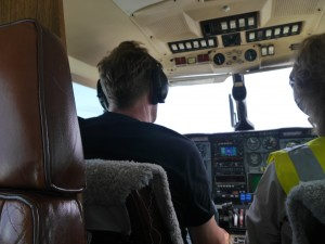Colin and Lee at the helm. Photo by Liz Corry