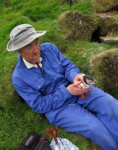 Ian Buxton and puffin. Shiant Isles 2009